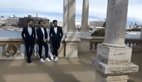 Left to right: Ignazio Piero and Gianluca standing in from of a wall with columns with the river behind them