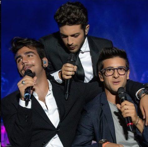 Ignazio, Gianluca and Piero sitting on stage singing
