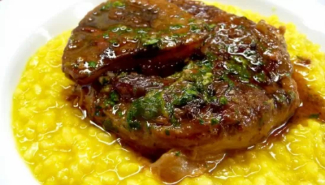 A photo of Ossobuco with saffron rice