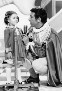Black and white photo of Cino Tortorella talking to a little girl on the show