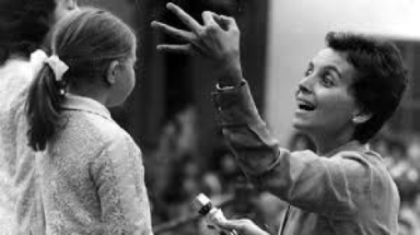 Black and white photo fo Mariele Ventre teaching children