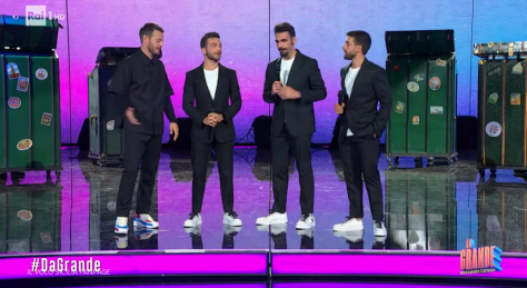 Cattelan and IL VOLO speaking on stage