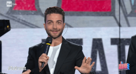 Gianluca speaking on stage