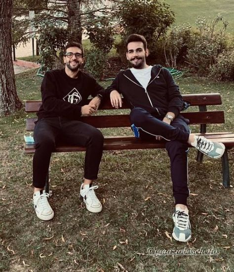 Piero and Ignazio sitting on a park bench