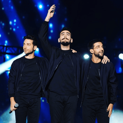 Left to right: Gianluca, with Ignazio gesturing toward heaven Piero on stage after they sang Your Love