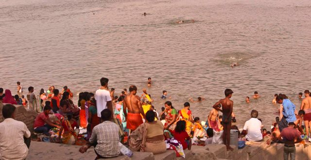 Devotees taking bath on a special day of full moon at Kashtaharni Ghat