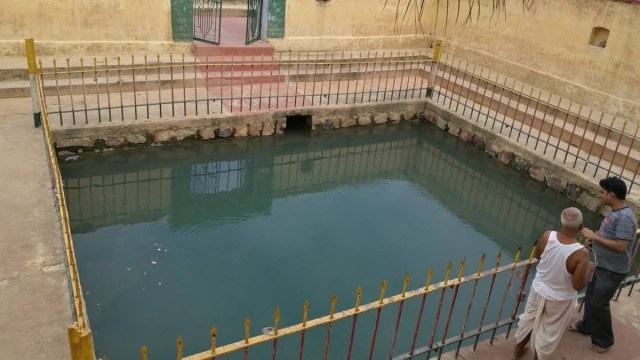 Hot Spring enclosed by a grilled fence called Sita Kund Picture by Pankaj