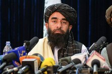 Taliban spokesperson Zabihullah Mujahid looks on as he addresses the first press conference in Kabul on August 17, 2021…