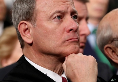 FILE - U.S. Supreme Court Chief Justice John Roberts listens as President Donald Trump delivers his first State of the Union address in the House chamber of the U.S. Capitol in Washington, Jan. 30, 2018.