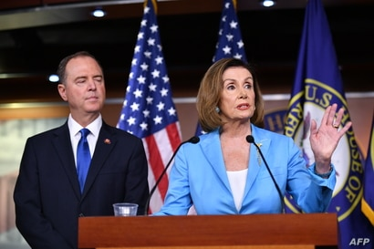 FILE - House Speaker Nancy Pelosi and House Intelligence Committee chairman Adam Schiff speak during a press conference at the U.S. Capitol in Washington, Oct. 2, 2019.
