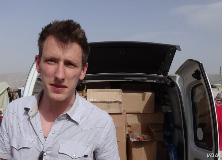 Abdul-Rahman (Peter) Kassig, an American aid worker, making a food delivery to refugees in Lebanon's Bekaa Valley, May 2013. Kassig is a being held captive by Islamic State militants. (Courtesy of Kassig family)