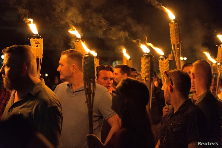 White supremacists carry torches on the grounds of the University of Virginia, on the eve of a planned