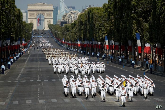 French troops descend the avenue des Champs Elysées during the July 14 parade in Paris, France, Saturday July 14, 2018.