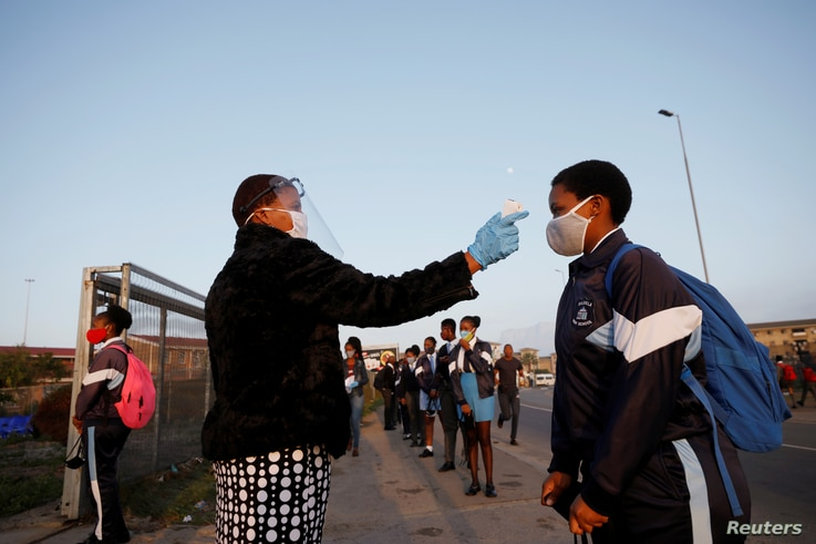 FILE PHOTO: A learner is screened as schools begin to reopen after the coronavirus disease (COVID-19) lockdown in Langa