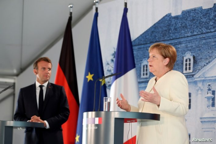 German Chancellor Angela Merkel and French President Emmanuel Macron give a joint press conference after a bilateral meeting at…