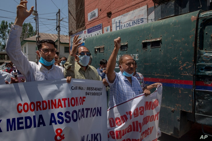 Kashmiri journalists shout slogans during a protest against a new media policy that was announced last month in Srinagar,…