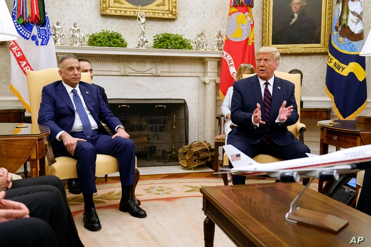 President Donald Trump meets with Iraqi Prime Minister Mustafa al-Kadhimi in the Oval Office of the White House, Thursday, Aug…