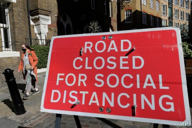 A sign is placed across a closed road in London, Thursday, Sept. 24, 2020, after Britains Prime Minister Boris Johnson…
