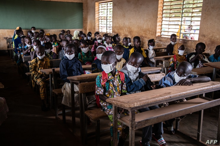 Children sit in their classroom on the first day of the new school year, in Ouagadougou, on October 1, 2020. (Photo by OLYMPIA