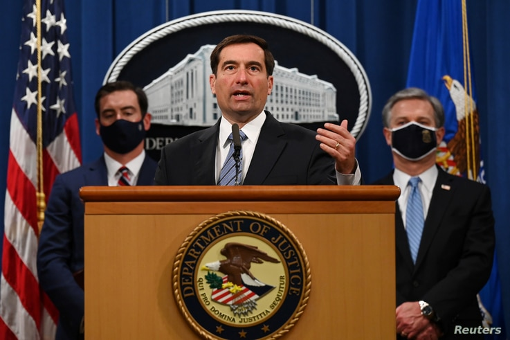 Assistant Attorney General John C. Demers of the National Security Division speaks during a press conference to announce that…