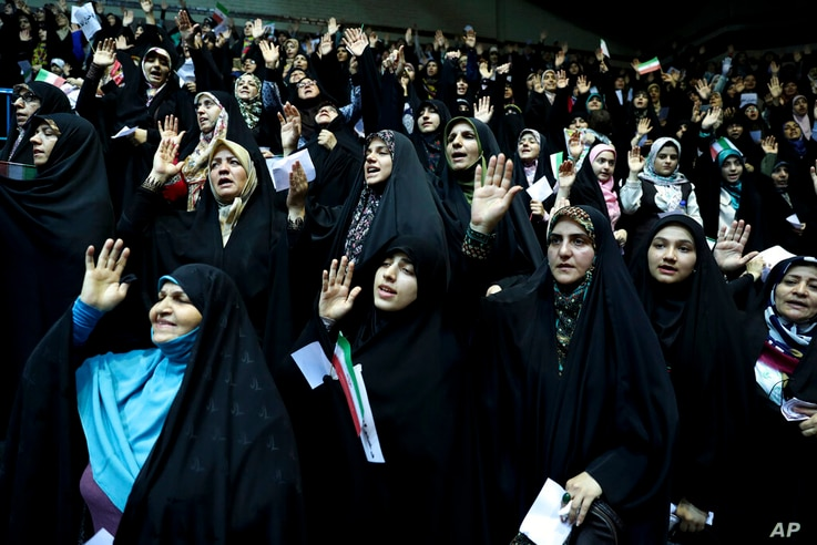 In this Thursday, July 11, 2019 photo, veiled Iranian women attend a ceremony in support of the observance of the Islamic dress…