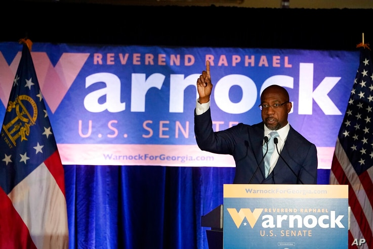 Raphael Warnock, a Democratic candidate for the U.S. Senate speaks during a rally, Tuesday, Nov. 3, 2020, in Atlanta. (AP Photo…