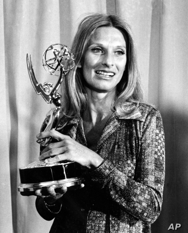 """FILE - Cloris Leachman poses with her Emmy award for outstanding single performance by an actress in """"A Brand New Life"""" at the…"""