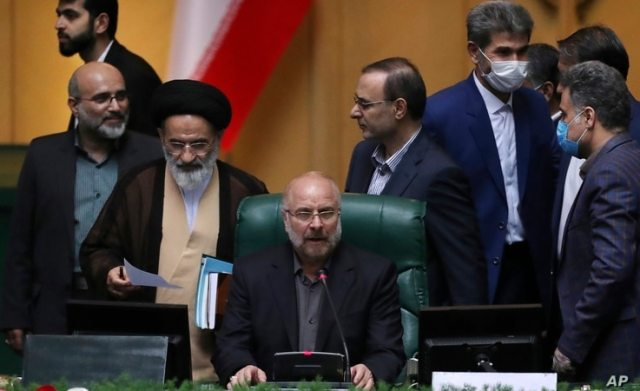 FILE - Mohammad Bagher Qalibaf speaks after being elected as speaker of the parliament, in Tehran, Iran, May 28, 2020.