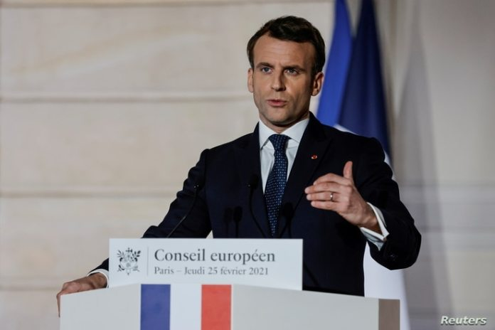 French President Emmanuel Macron gives a press conference after a European Council summit organized by videoconference, in…