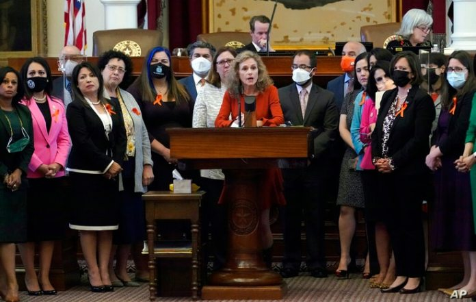 On Wednesday, May 5th, Texas Rep. Donna Howard (D-Austin) stood with members of the House of Representatives in the center of the podium...