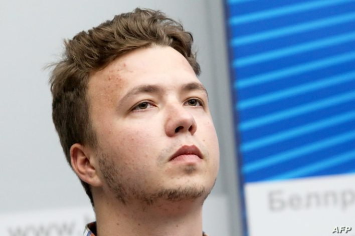 (FILES) In this file photo taken on June 14, 2021 Belarus activist Roman Protasevich, 26, takes part in a briefing for…