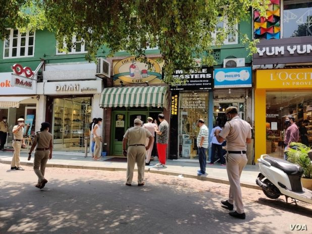 Police patrol markets in New Delhi, June 7, 2021, to ensure that people adhered to social distancing norms.