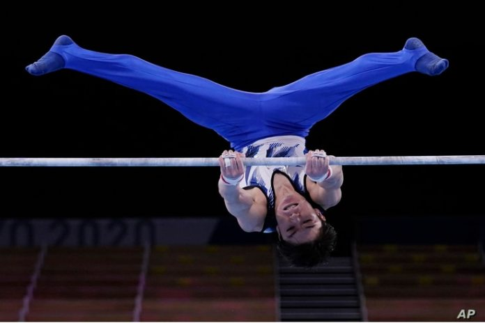 Kohei Uchimura of Japan competes on the horizontal bar during the men's artistic gymnastics qualification at the 2020 Summer Olympics in Tokyo, Japan, July 24, 2021.