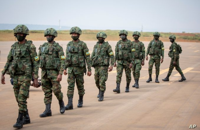 Rwandan armed forces prepare to board a flight at the airport in Kigali to Mozambique, July 10, 2021.