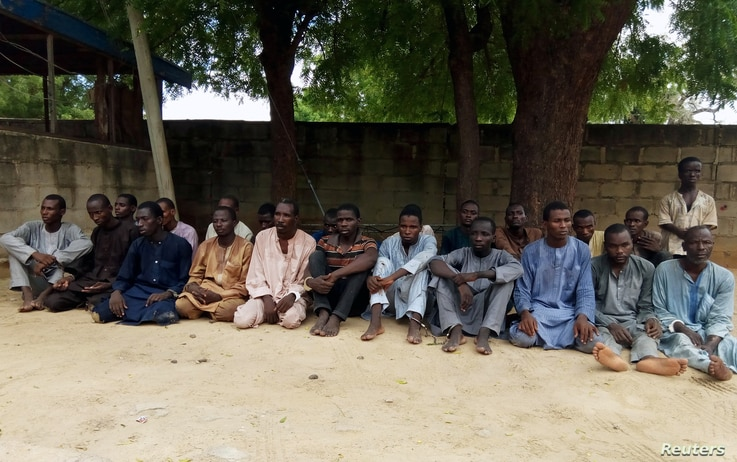FILE - Suspected members of Islamist militant group Boko Haram are pictured after being arrested in Maiduguri, Nigeria, July 18, 2018.