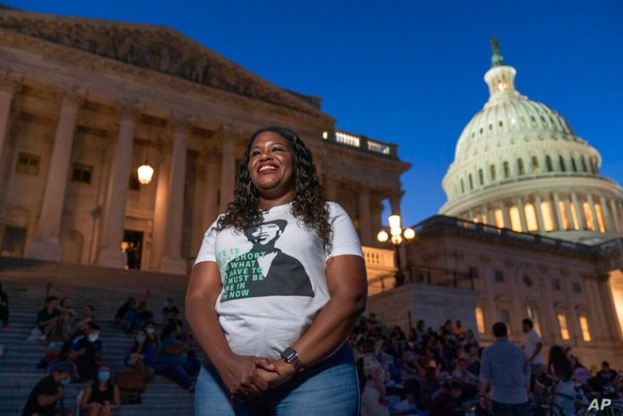 Rape.  Corey Bush, D-Mo., talks to reporters while camping outside the U.S. Capitol in Washington, Monday, Aug. 2, 2021, as…