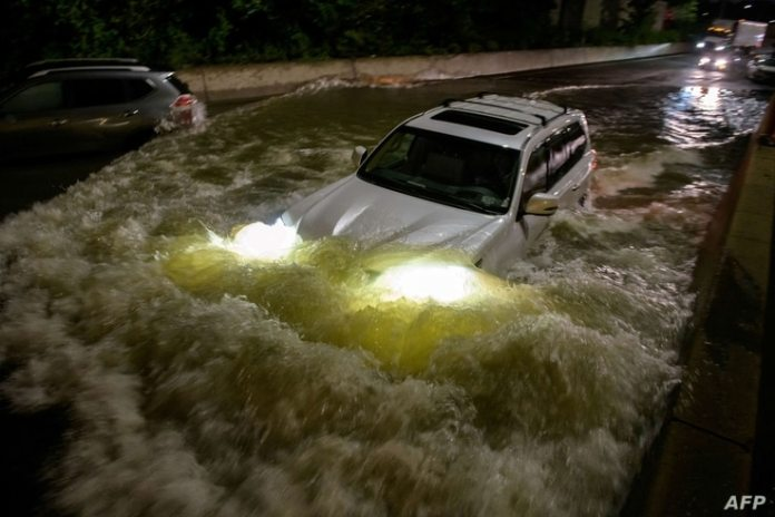 In the early morning of September 2, 2021, a motorist drove through a flooded highway in Brooklyn, New York.