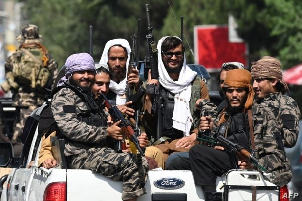 Taliban fighters patrol on vehicles along a street in Kabul on September 2, 2021. (Photo by Aamir QURESHI / AFP)