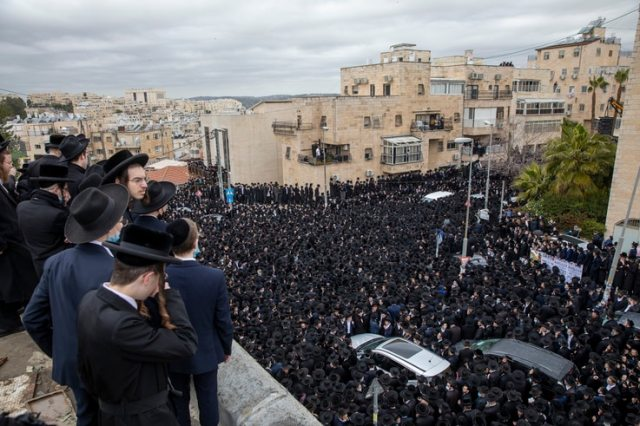 Thousands of ultra-Orthodox Jews participate in funeral for prominent rabbi Meshulam Soloveitchik, in Jerusalem, Sunday, Jan…