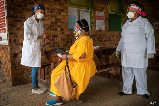 A South African woman is being briefed on before taking a COVID-19 test at the Ndlovu clinic in Groblersdal, 200 km northeast of…