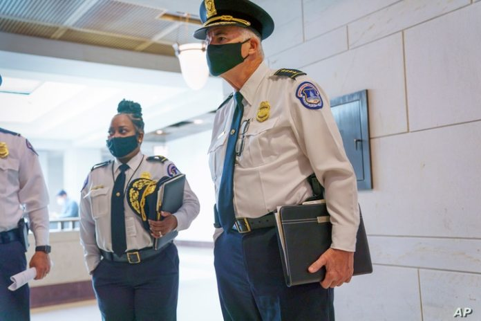 US Capitol Police Chief Thomas Manger, joined on the left by Assistant Chief Yogananda Pitman, heads for a closed-door meeting...