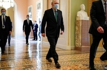 FILE - Senate Majority Leader Mitch McConnell (R-KY) walks to the Senate Chamber on Capitol Hill in Washington, Sept. 30, 2020.