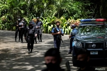 Nicaraguan police officers are pictured at the entrance to the house of opposition leader Cristiana Chamorro after prosecutors…