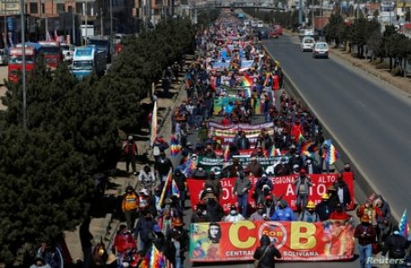 People demonstrate during a march organised by the COB, Bolivian Workers' Center, to demand early elections, amid the…