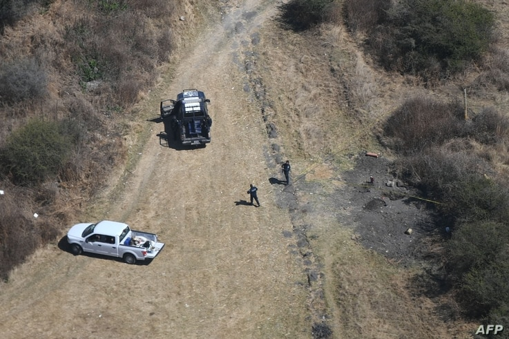 Aerial picture showing Federal police officers securing a clandestine fuel intake in the Mexican state of Guanajuato taken on…