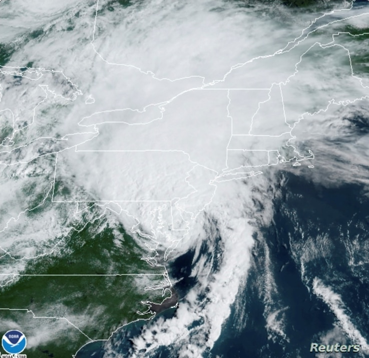 A satellite image shows Tropical Storm Isaias as it progresses over the northeast United States August 4, 2020.  NOAA/Handout…