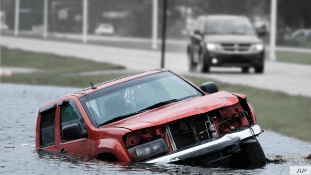 Image of car submerged in water, partial graphic