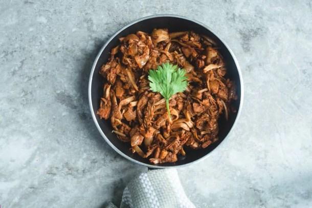 vegan jackfruit in sauce pan with cilantro