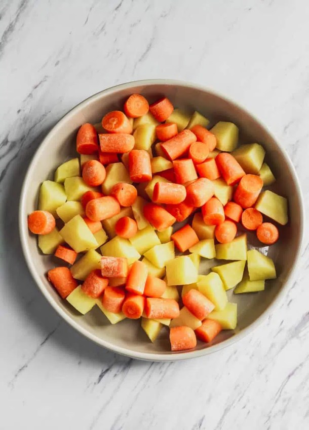 carrots and potatoes in tan bowl