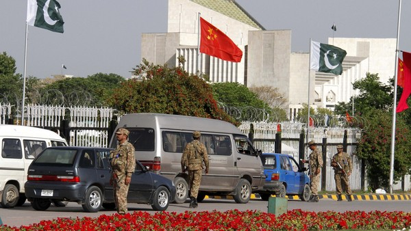 epa04713419 Pakistani army soldiers secure the road leading towards Prime Minister Secretariat where meeting between Pakistan Prime Minister Nawaz Shrif and Chinese president Xi Jinping is taking place in Islamabad, Pakistan 20 April 2015. After more than six decades of a relationship focused on defence and security, China and Pakistan are also developing an economic partnership with trade and investment agreements worth 46 billion dollars. The deals are part of China-Pakistan Economic Corridor (CPEC) project launched during the visit of Chinese President Xi Jinping who arrived in Islamabad on Monday on his first state visit. The corridor is to be a complex network of highways, railways, investment zones and business centres, linking China's western Xinjiang autonomous region to Pakistan's Gwadar deep sea port in the south-western province of Balochistan. EPA/SOHAIL SHAHZAD